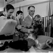 Joseph H. Biden Jr., left, offers words of encouragement to his bedridden son, Beau, before Bidden was sworn in as the United States Senator from Delaware in ceremonies in Wilmington hospital on Jan. 5, 1973. Biden's other son, Hunter, talks with Robert Hunter, Biden's father-in-law. Beau is still in traction from an auto accident on Dec. 18, in which the Senator's wife and daughter were killed. (AP Photo/Brian Horton)