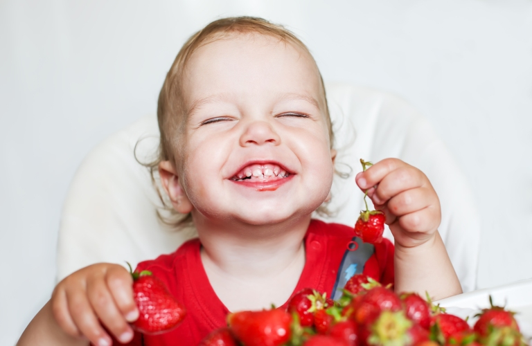 bigstock-happy-toddler-boy-eating-straw-65789122.jpg