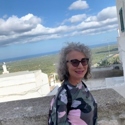 The beautiful Elaine taking in Ostuni.